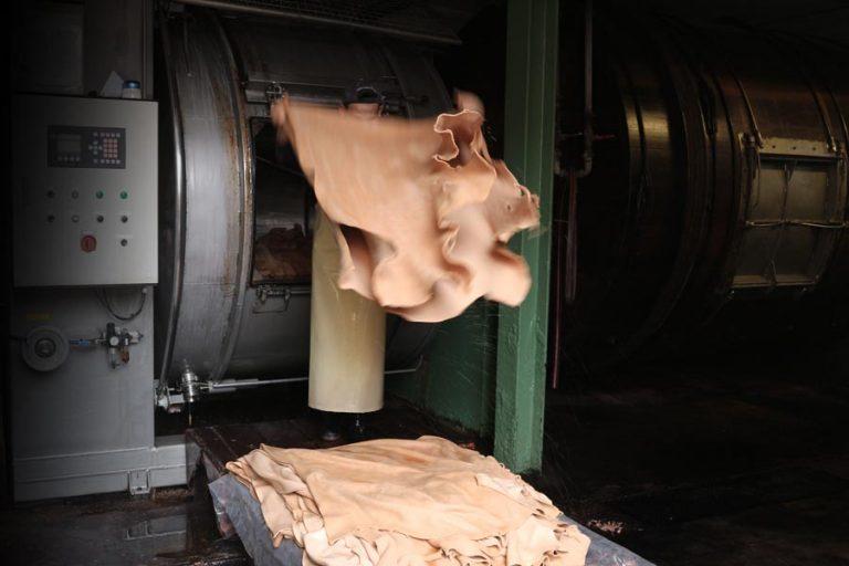 Leather tanning process: tan tumbling.
