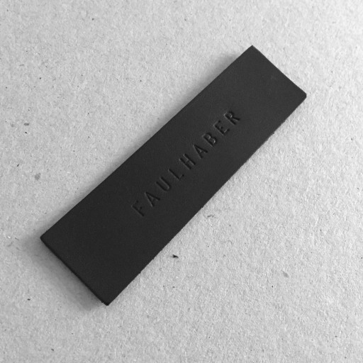 Faulhaber Products logo embossed leather