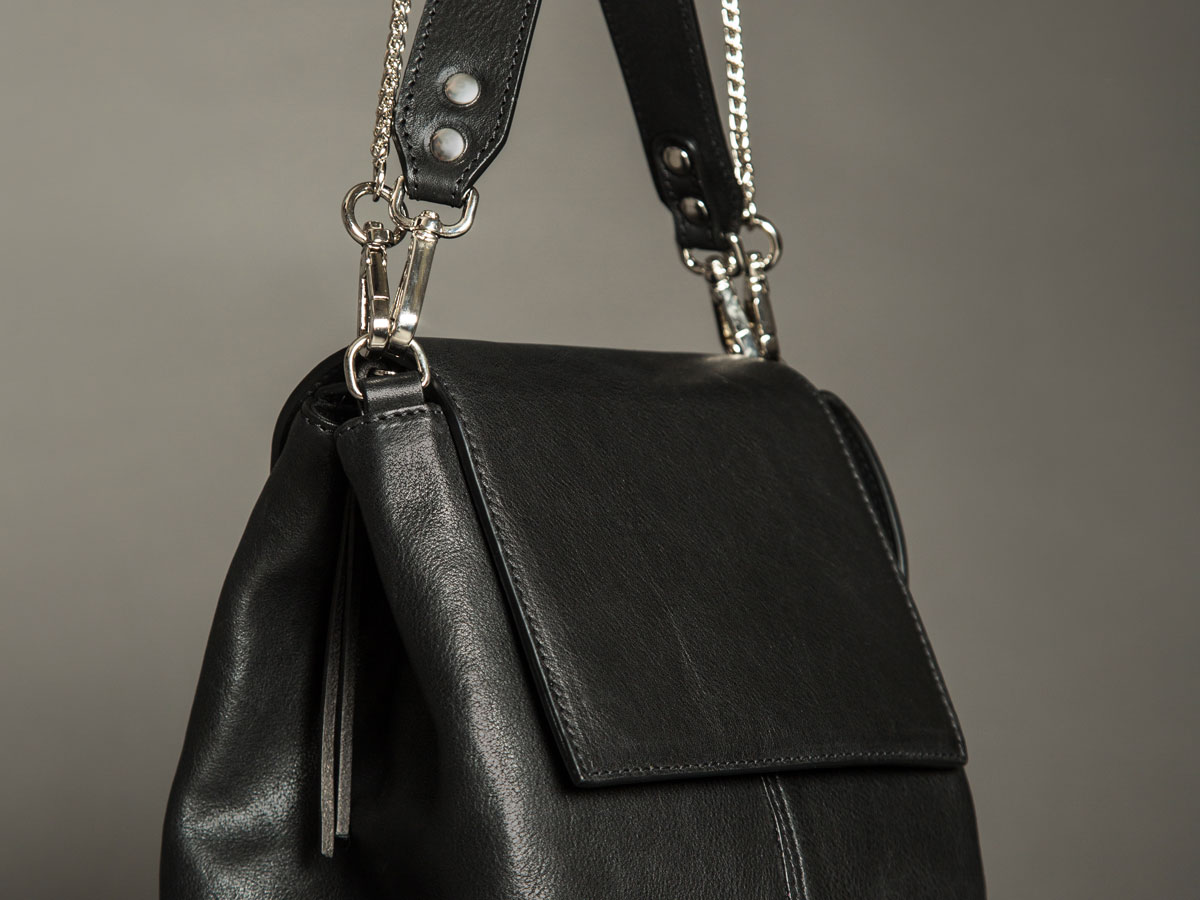 Metal trims details of Faulhaber Products ROTA handbag in black leather