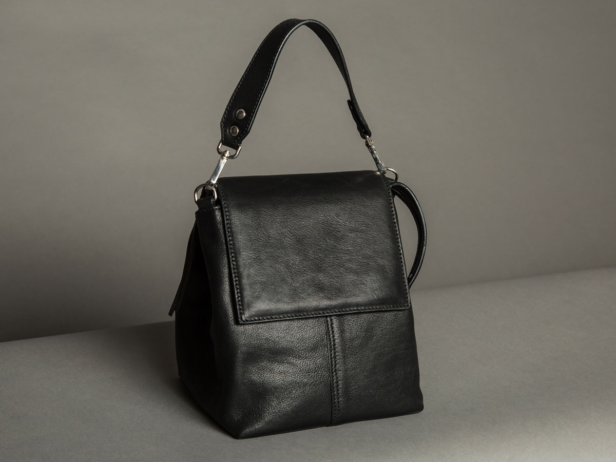 Side view of Faulhaber Products ROTA handbag in black shiny leather