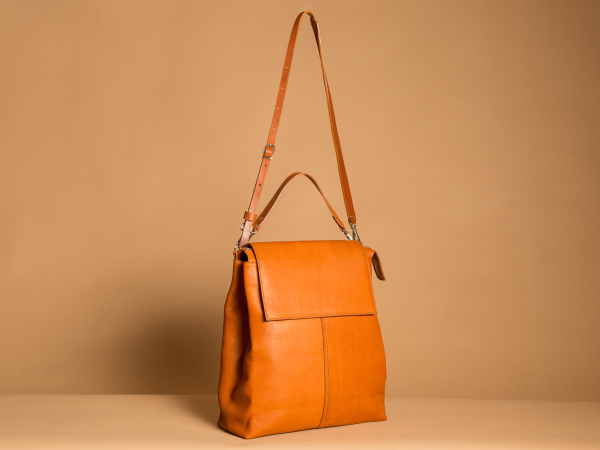 Side view of ROTA handbag in cognac vegetal tanned leather by Faulhaber Products