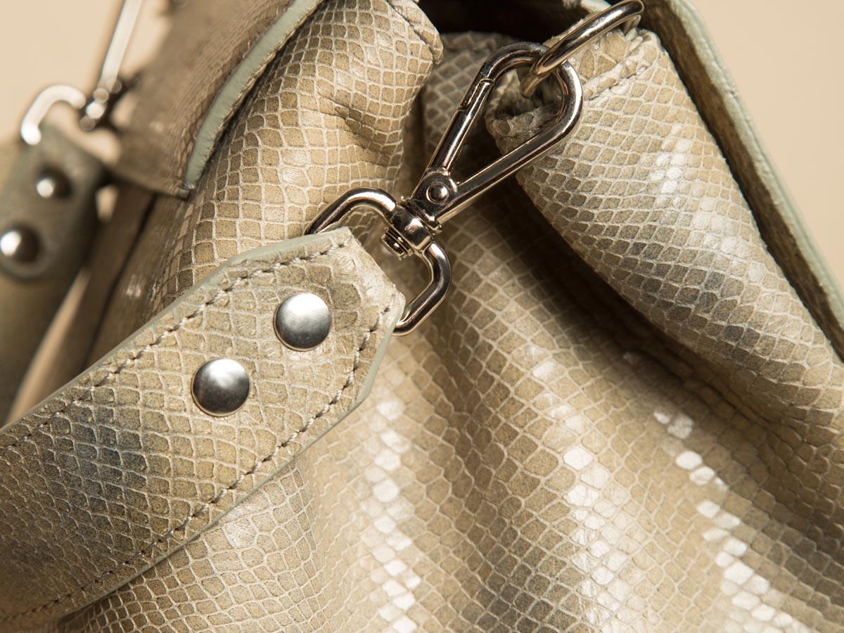 Metal trims of ROTA handbag in special fake snake leather
