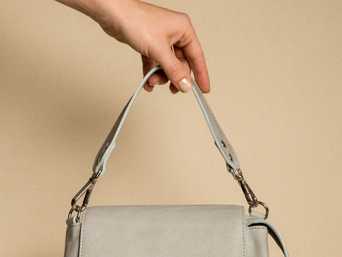 Details of arm carry handle of Faulhaber Products ROTA handbag in grey cow leather