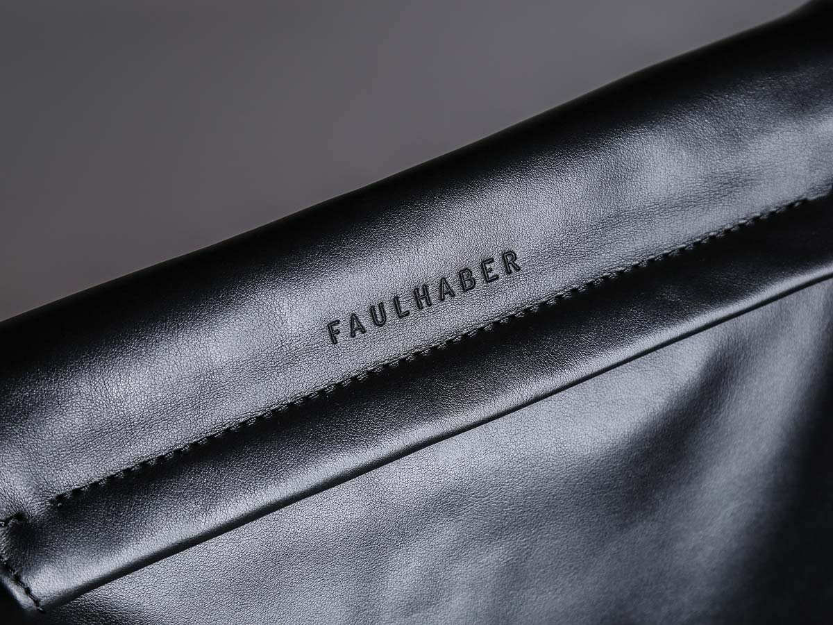 Logo of Faulhaber Products SOL handbag in black natural leather