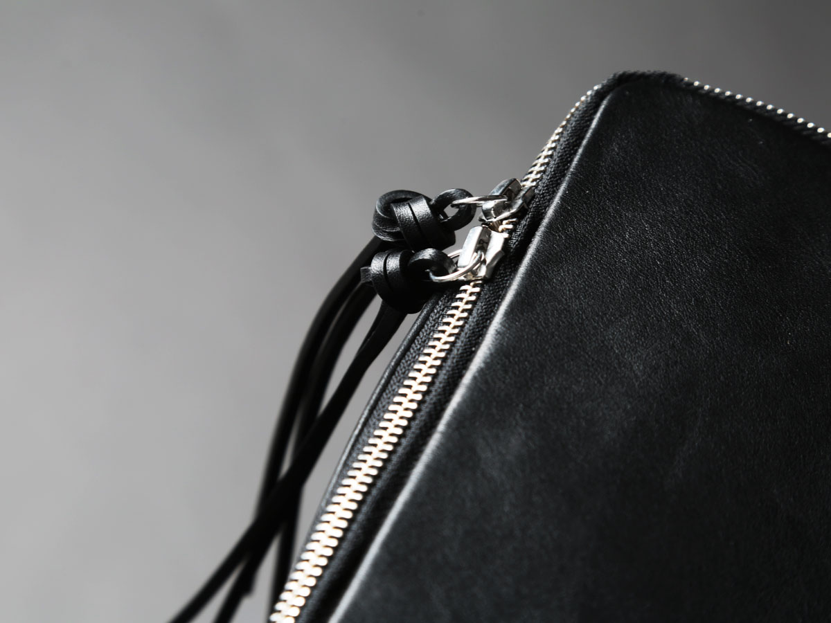 Zip detail of Faulhaber Products SYN backpack in black leather