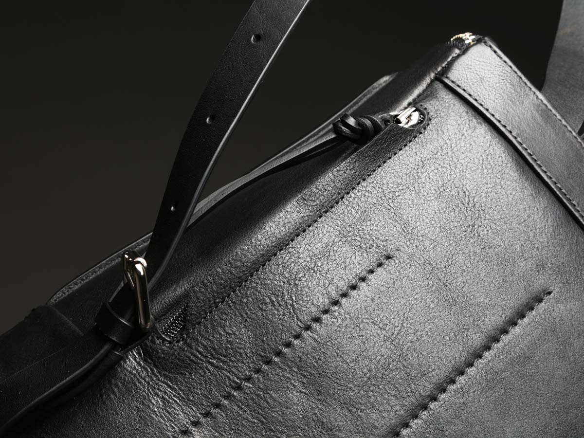 Back side of Faulhaber Products SYN backpack in black leather