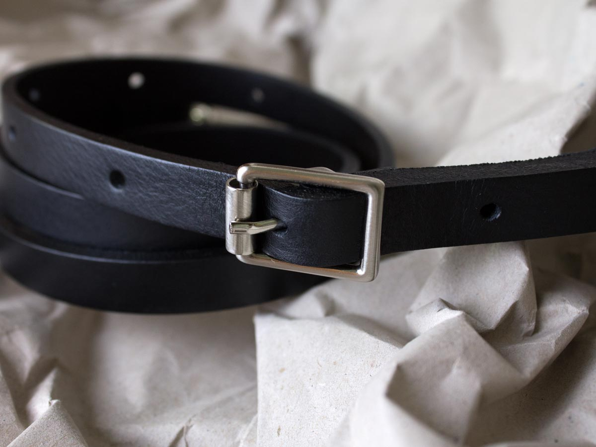 Silver buckle of Faulhaber Products BUR strap from vegetable tanned bovine leather